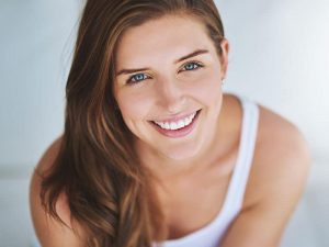 A woman with Restorative Dentistry treatment in Vancouver