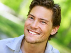 A man with a teeth whitening treatment in Vancouver